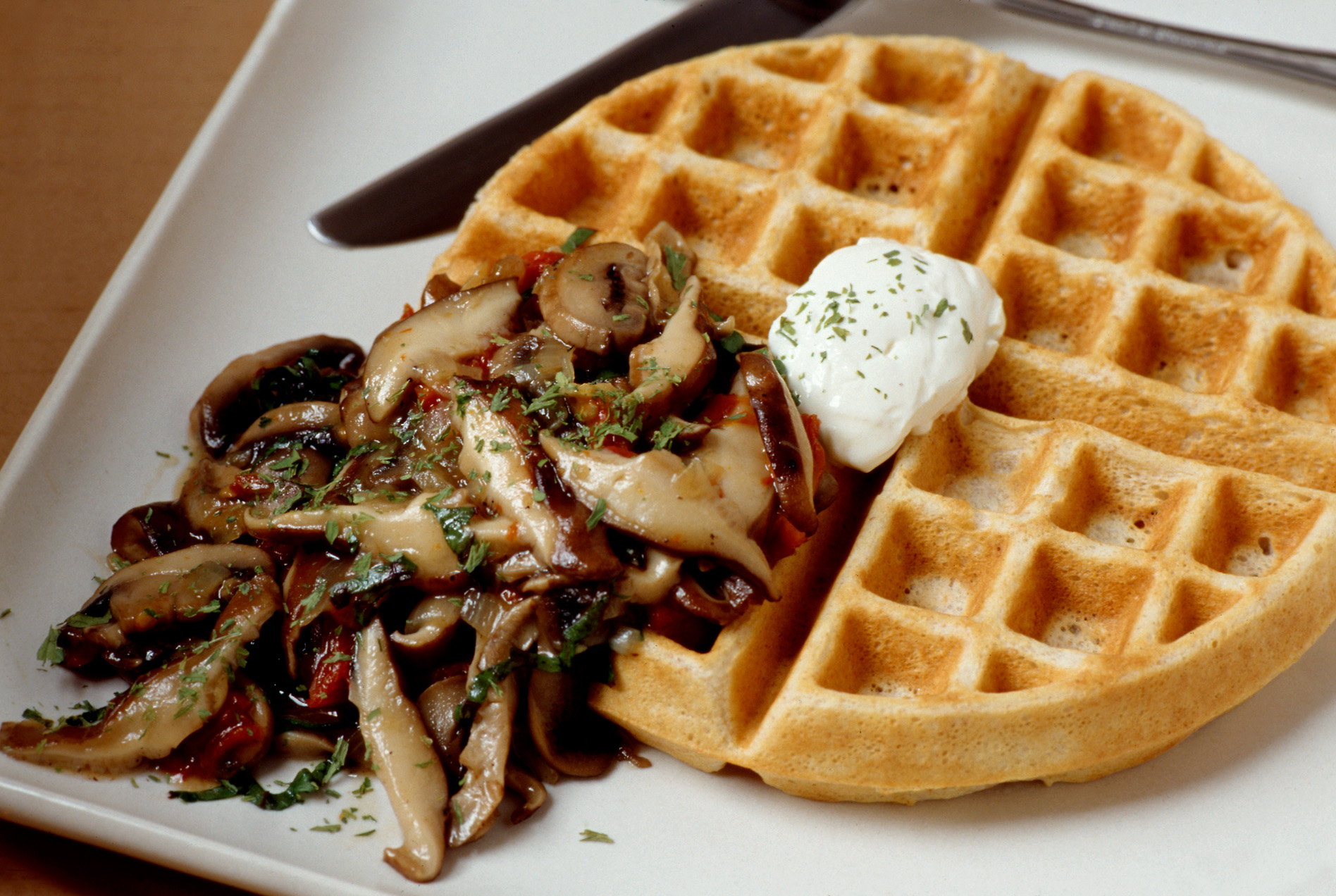 Savory Waffles with Cremini Mushrooms and Poached Eggs. Egg yolks blend with the mushrooms' juices to form an incredible, umami-packed sauce.